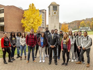 President Anthony Jenkins with WVSU students by the clock tower.