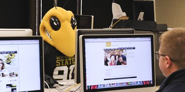 Mascot surfing the internet