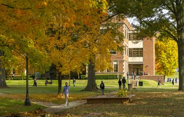 Fall scene with trees of campus in front of Ferrell Hall.