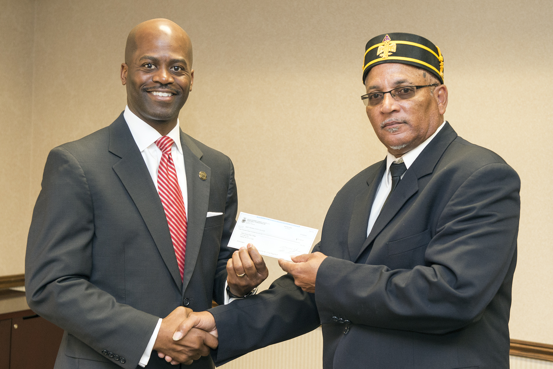 President Jenkins receives a donation from Kenneth Hale and the Scottish Rite