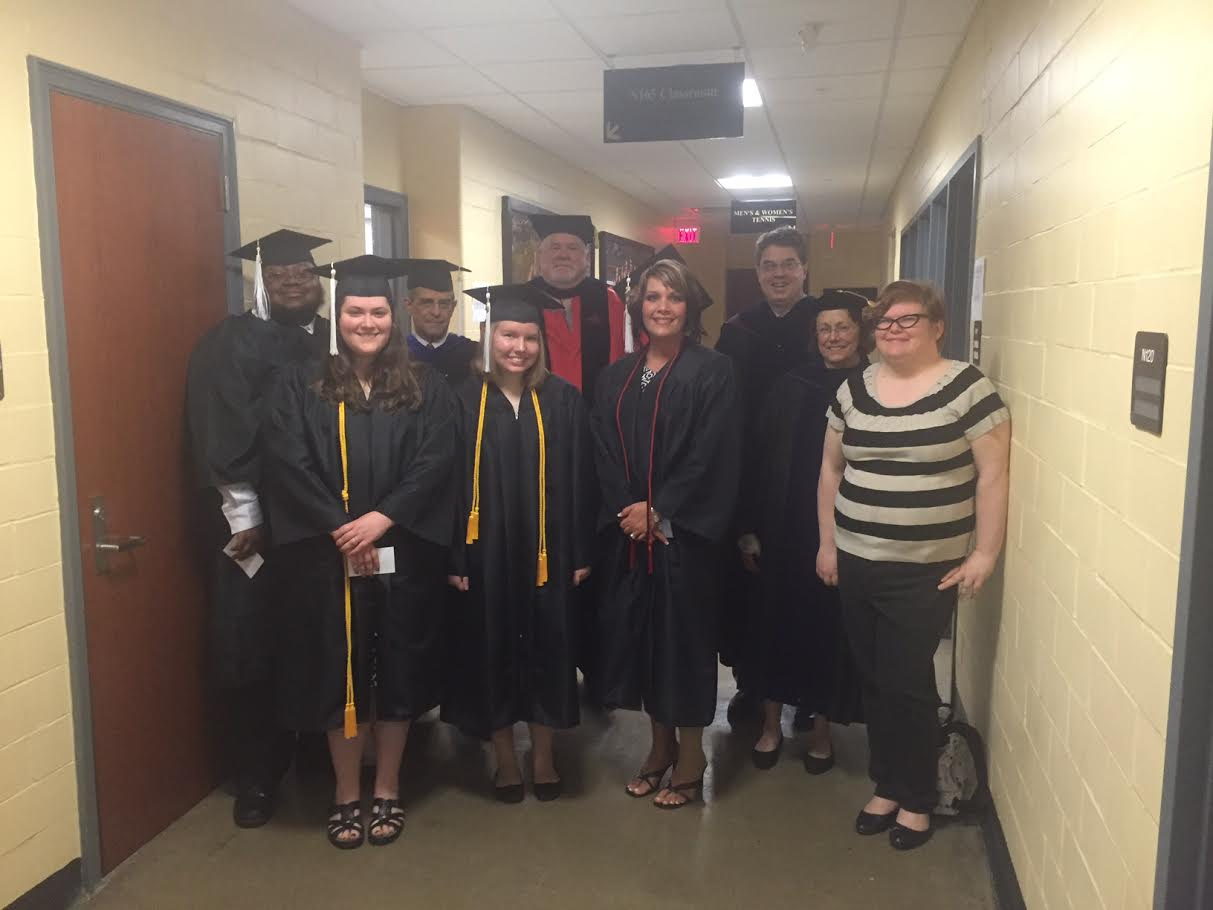 A photo of some of the Spring 2016 English graduates with some English Faculty members.