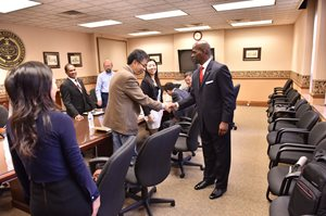 Former WVSU president, Anthony Jenkins, shakes hands with an administrator from NBUT.